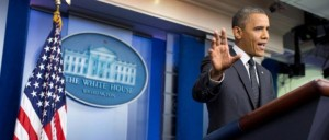 obama press briefing with hand up to camera