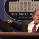 Melissa McCarthy as Sean Spicer kicking leg with high heel