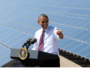 Obama speakng in front of solar panels