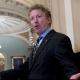 Rand Paul speaking to reporters as he walks through Capitol