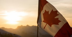 Canada-flag with backdrop landscape