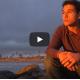 boy pondering on seashore