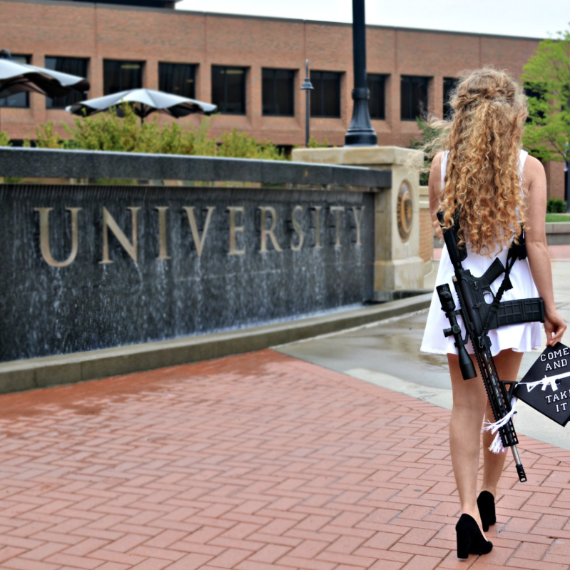 Girl wears gun in viral graduation photos  5/16/18