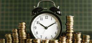 Clocks among stacks of money