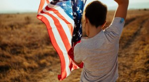 American flag held by young boy