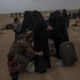 ISIS-U.S.-backed Syrian Democratic Forces checks a civilian for weapons and explosives